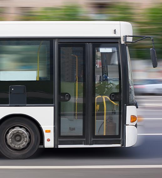 Image of a transit bus driving.