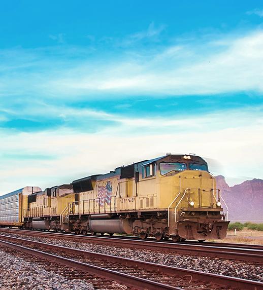 Diesel Locomotive traveling on tracks.